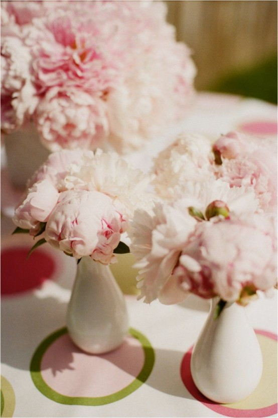 white bud vases with light pink peonies can be placed here and there as decorations, centerpieces and they will bring a cool aroma