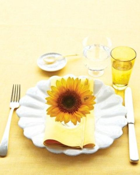 accentuate each place setting with a single bold bloom to give it a bright and cool summery feel