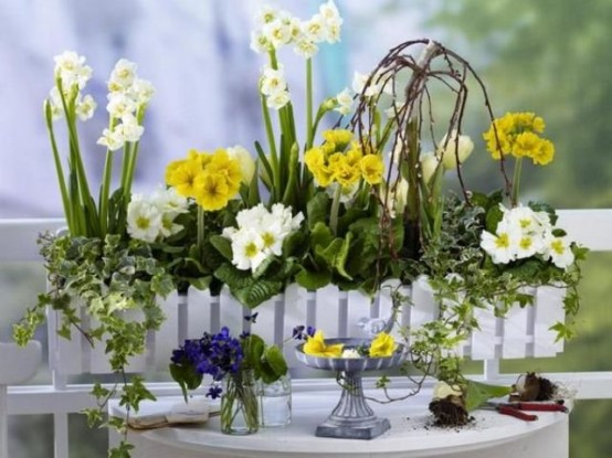 a white fence planter with neutral and yellow blooms will brign a bright summer touch to any of your spaces