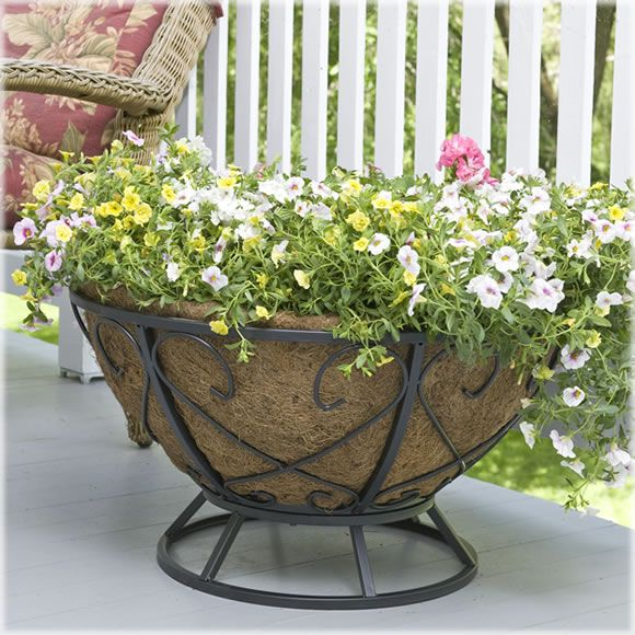 an oversized turf planter with lots of colorful blooms will make your outdoor space more elegant and summery