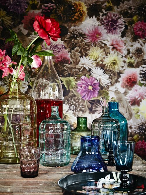 colorful vintage bottles and vases with some bold peonies in them will give you bright summer like decor and a bold touch