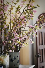 vintage vases with blooming cherry branches are always a good idea for every space, both indoor and outdoor