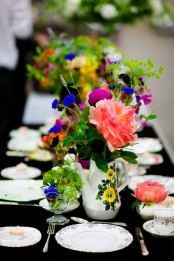 vintage painted teapots and glasses with super bright blooms and greenery are nice to accent any tablescape