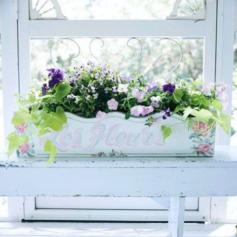 a vintage painted windowsill planter with summer blooms will decorate your window both indoors and outdoors