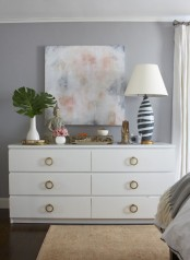 style your Malm dresser with brass ring pulls to make it look glam and timeless