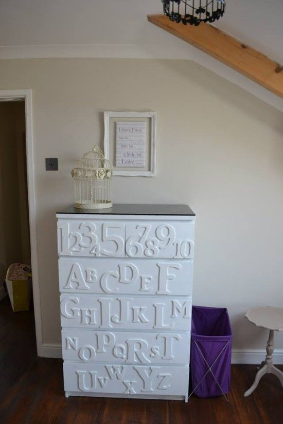 decorate your IKEA Malm dresser with white numbers and letters to let your kid learn and add a black countertop for a more stylish look