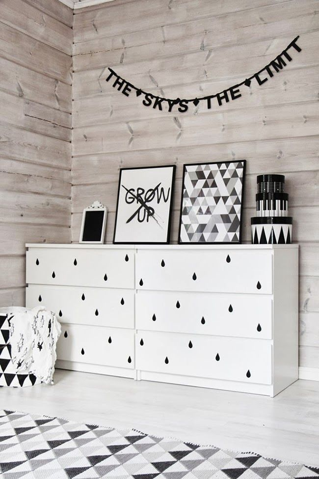 a simple and cute IKEA Malm hack with black raindrop decals on the drawers is a cute idea for a Nordic nursery
