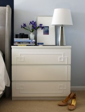 a white IKEA Malm dresser as a nightstand with elegant trim is an easy hack to realize