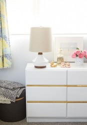 an IKEA Malm hack with upholstered drawers and gold contact paper for a contemporary space