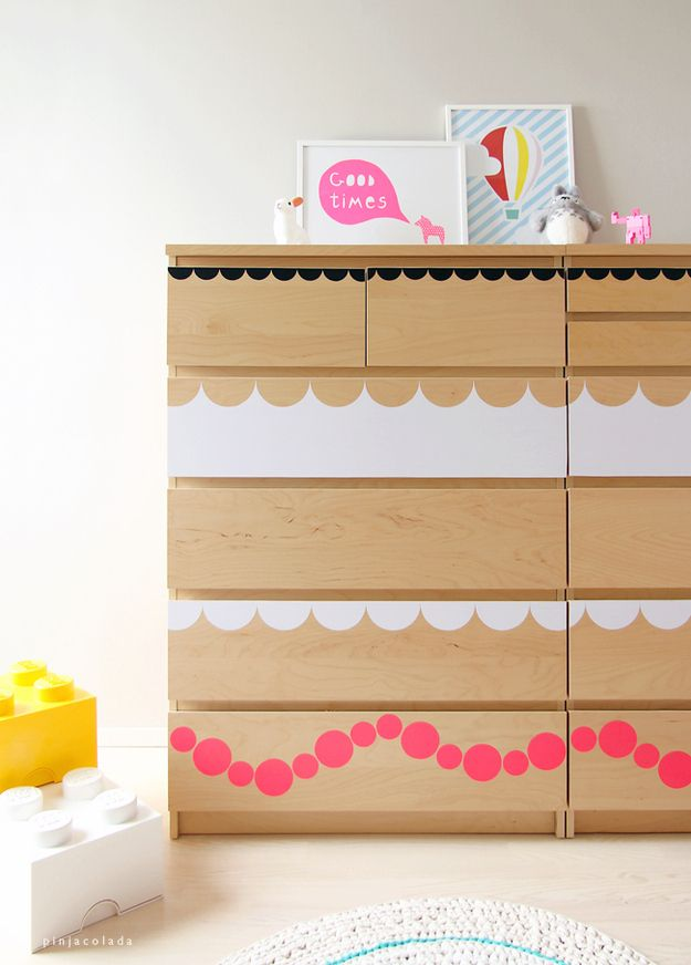 a light stained IKEA Malm dresser hacked with simple white and pink decals on the drawers