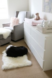 a white IKEA Malm dresser is a perfect fit for a contemporary nursery done in neutrals