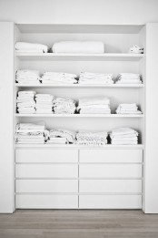 a built-in closet with open shelving and IKEA Malm dressers for smaller items is a simple and cool idea