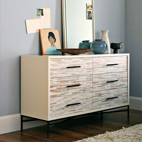 a catchy Malm hack with printed contact paper, black handles and framing and legs
