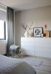a welcoming contemporary bedroom with an IKEA Malm dresser