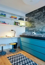 a kids' bed placed on turquoise IKEA Malm dressers maximizes the storage space without cluttering the room