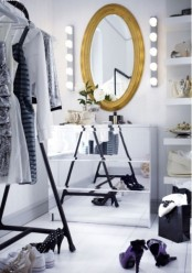 a glam and bold IKEA Malm dresser hack with mirrors all over is a cool idea for a closet