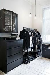 a Scandinavian closet done with a black Malm dresser for smaller items