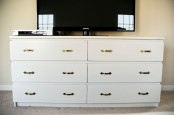 a simple IKEA Malm dresser hack with vintage brass handles as a TV stand