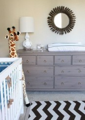 a chocolate brown weathered wood IKEA Malm with ring pulls as a changing table
