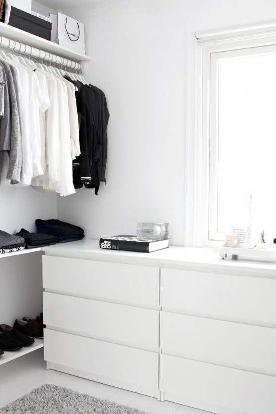 a Nordic closet done with open shelving, racks and IKEA Malm dressers