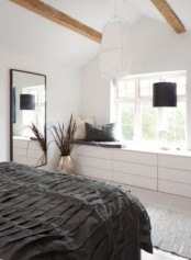 a Scandinavian bedroom with IKEA Malm dressers at the window that will give much storage space
