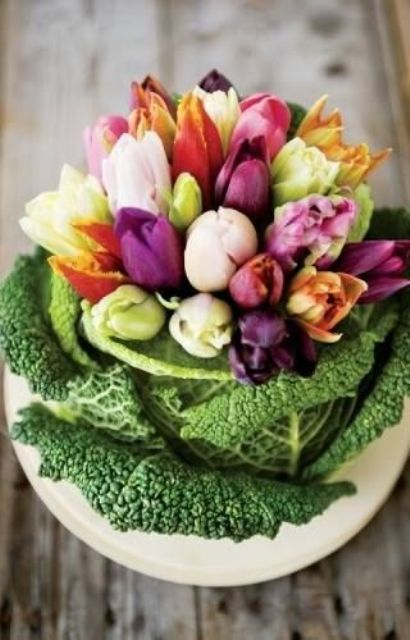 place colorful tulips into a cabbage instead of a usual vase to compose a cute rustic-inspired centerpiece