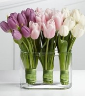 a large clear glass bowl with three tulip arrangements – in white, blush and lilac for creating an ombre effect