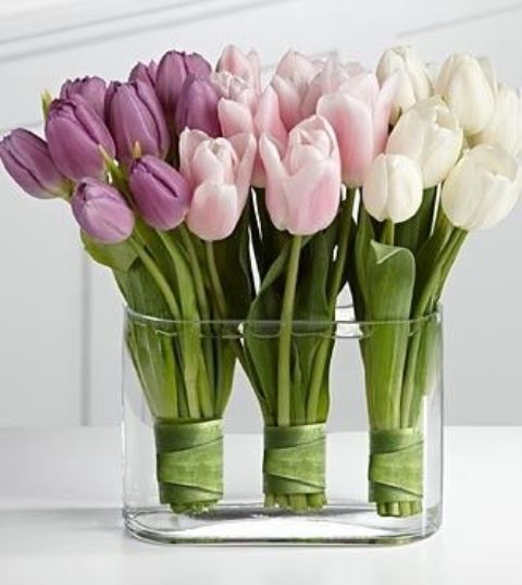 a large clear glass bowl with three tulip arrangements - in white, blush and lilac for creating an ombre effect