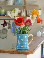 a vintage spring decoration with a blue retro jar and bright tulips is a cool idea thta is easy to compose