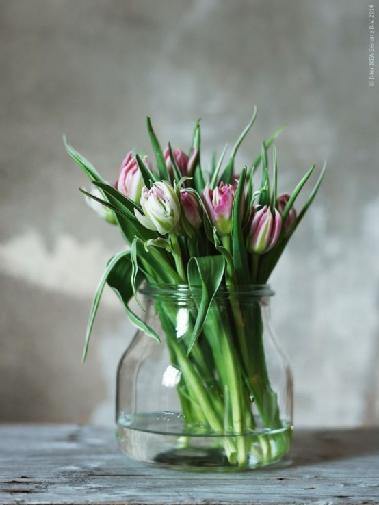 a large jar with pink tulips is a simple spring-like decoration that can be made anytime