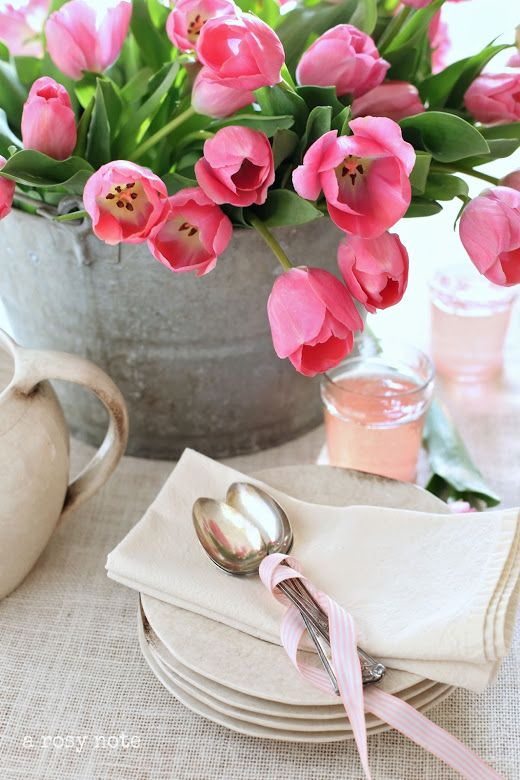 a galvanized bucket with hot pink tulips is a nice centerpiece for any party or a bold decoration for indoors and outdoors