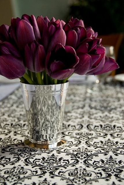 a polished mini bucket with deep purple tulips is a bold and refined spring centerpiece or decoration