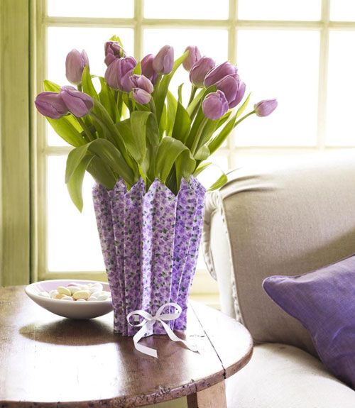 purple tulips in a vase covered with a purple paper cover is a bold vintage-inspired spring decoration