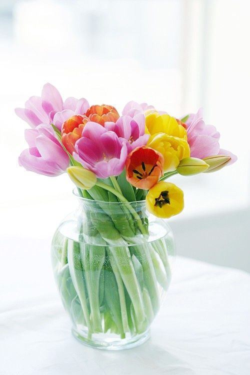 a clear glass vase with colorful spring tulips is a bright spring and Easter centerpiece that embraces the season