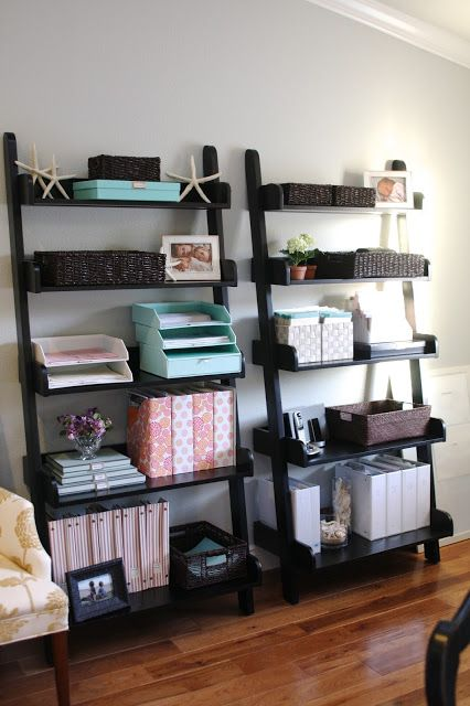leaning black open shelving units are great for storing various stuff, they don't look bulky and are comfortable in using