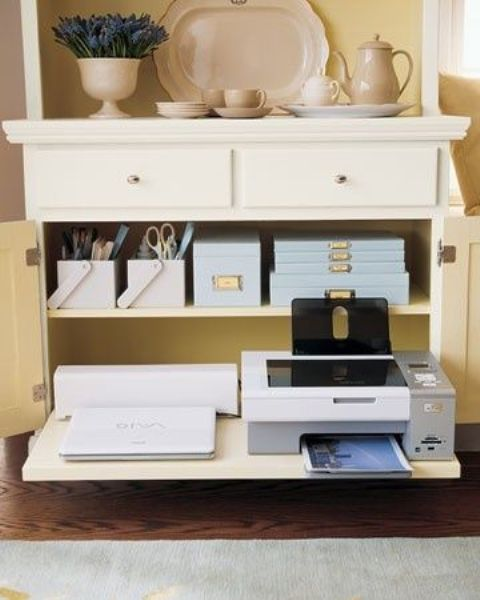 a neutral credenza with drawers to hide all the office supplies and other items that you need for work