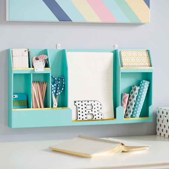 a colorful wall mounted storage unit with open departments is an ultimate choice for a modern home office