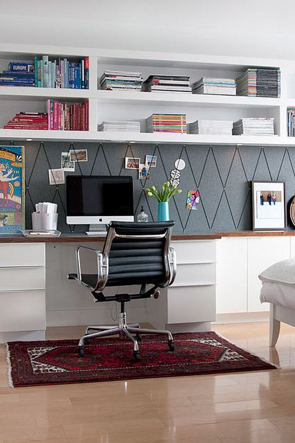 large open shelves over the desk that take a whole wall give much storage space to your home office