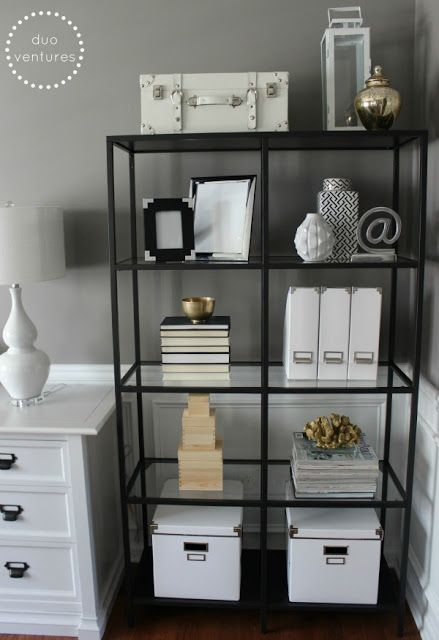 a simple black open shelving unit is a comfortable storage piece to hold and store everything you want and make your space more organized