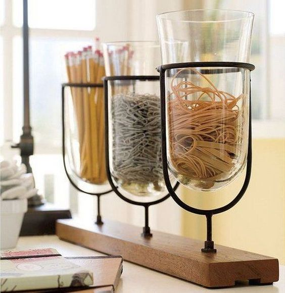 a wooden shelf with glass jars attached   these jars may be used for organizing anything you want
