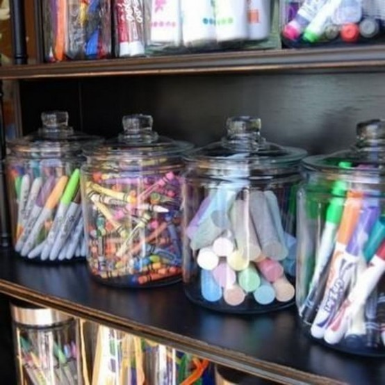 large glass jars for storing crayons, pens, pencils, markers and other office stuff