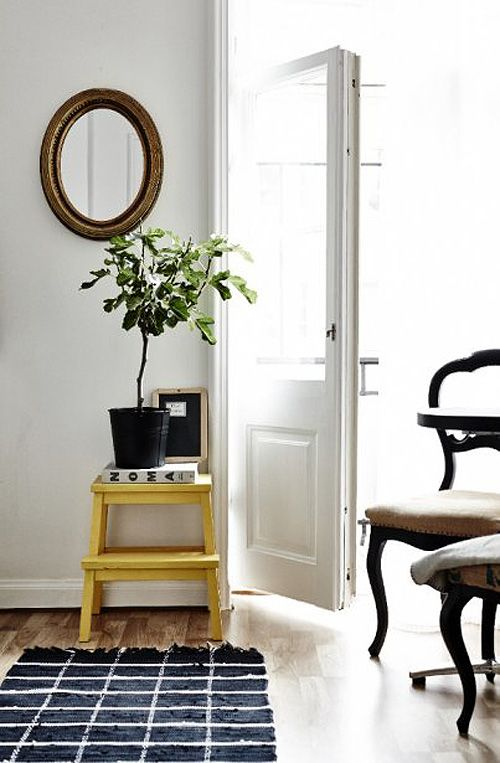 Yellow IKEA Bekvam stool as a plant stand