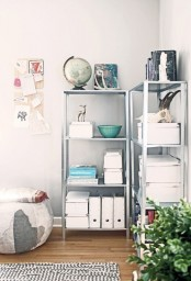 IKEA Hyllis shelves in a home office, with boxes for storage, bowls, books, animal skulls and even a globe
