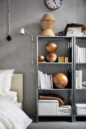 IKEA Hyllis shelves with books, artworks, candles, magazines and everything else you may need