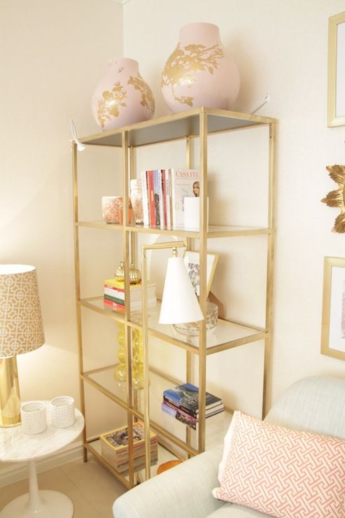 gilded IKEA Hyllis shelves for storing books, lamps, candle holders and oversized vases look very chic and shiny