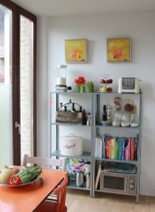 IKEA Hyllis shelves with books, bottles, jars and various kitchen appliances are very comfy
