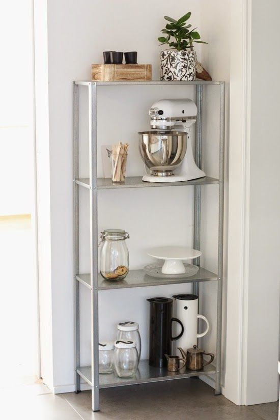 an IKEA Hyllis shelf is placed into an awkward nook for storage is great to use every inch of space
