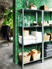 IKEA Hyllis shelves with towels and all the possible bathroom stuff stored on them