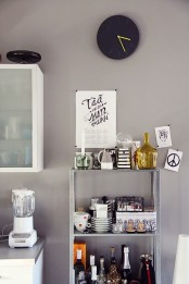 an IKEA Hyllis shelf with various kitchen stuff-it's ideal for kitchens as it's durable and comfortable in using