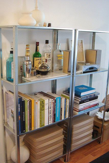 in your living room IKEA Hyllis shelves can also accommodate a home bar if needed